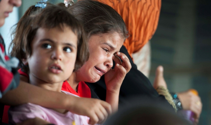A child cries in a military helicopter after being evacuated by Iraqi forces from Amerli, north of Baghdad, Aug. 29, 2014. A home to around 180,000 people, mostly Turkmen Shi'ites, the small town of Amerli is still holding out against repeated attacks by Islamic State fighters despite the fall of all the 34 villages surrounding it. (Photo: Reuters/Stringer)