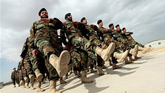 Afghanistan National Army officers march during a graduation ceremony at a training center in Herat, west of Kabul. Around 1, 200 national army officers graduated after receiving a 3 month training program in Herat. (AP Photo/Hoshang Hashimi)