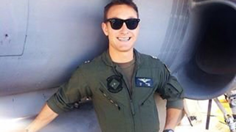 A Navy pilot missing and presumed dead after two jets collided over the western Pacific Ocean has been identified as Lt. Nathan Poloski, 26, of Lake Arrowhead, California. Poloski was flying an F/A-18 Hornet when it collided with another Hornet aircraft during routine flight operations Friday, Sept. 12, 2014. The pilot of the second plane was rescued, treated and has been released from the ship's medical facilities. Poloski's remains have not been found. He has now been declared presumed dead.