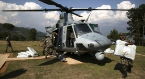 Nepali military service members unload supplies from a UH-1Y Huey in Charikot, Nepal, on May 5. Screenshot Credit, CNN