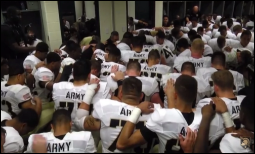 Army football players are shown praying together after beating Temple last week. (Photo: Screen Shot from Youtube)