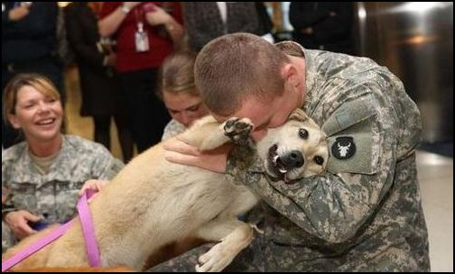 Soldier embraces his canine companion. (Photo: Public Domain)
