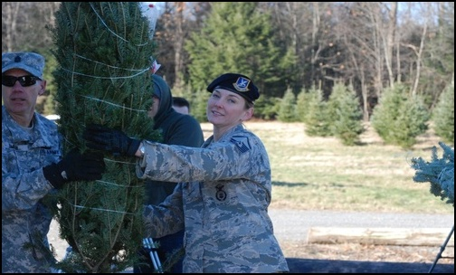 National Guard troops lend a hand in loading Trees for Troops. (Photo: Public Domain)