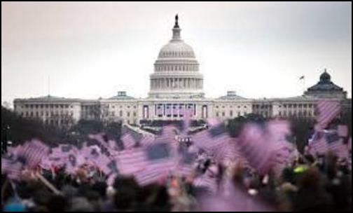 Attendees wave flags at the National Mall during presidential inauguration in Washington (Photo: Public domain)